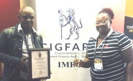 FOR GOOD GOVERNANCE: Enoch Mgijima budget and treasury political head Madoda Papiyane, left, and executive mayor Lindiwe Gunuza-Nkwentsha display an award for clean governance, which was received from the Institute for Municipal Finance Officers in Durban recently