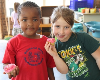 Enjoying cupcakes as part of Balmoral Girls' Primary School's 55th birthday, from left, pre-primary pupils Iyazi-Lomso Kobese and Maritza Jordaan