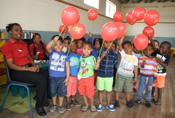 Playways pre-schoolers had fun during a visit by McDonalds staff, from left, Phumeza Maseti and Vuyiseka Mjalo