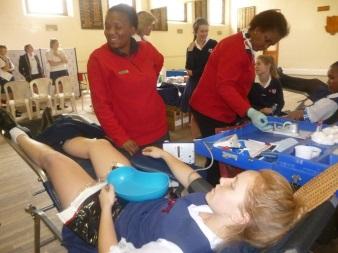 Carmen McEwan of GHS giving blood