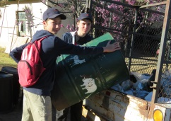 From left, Chris Grobbelaar and Kian Grobler of the Hangklip environment club helping to clean up the town