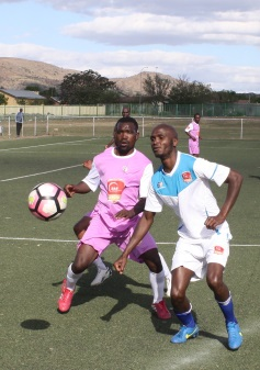 NO WAY THROUGH: Siyabonga Landelo of Valgas FC battles for the ball with Zixolisile Landu of Difra Stars during their SAB league encounter at the Dumpy Adams Sports ground last week.                                                                                                                     Picture: BHONGO JACOB