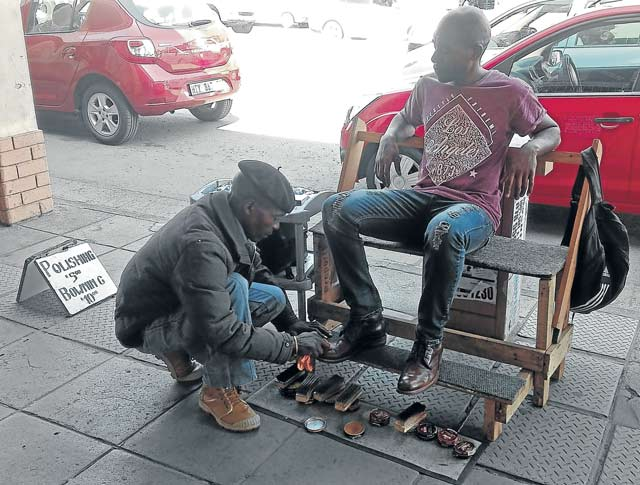 SMALL START:  Ntobeko   Bhunguza  recently started his own shoe-shining business in Cathcart Road in Komani Picture: BHONGO JACOB
