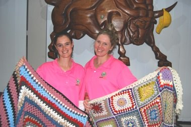 Several Komani women combined to crochet 10 blankets which were auctioned at a recent Round Table Gems function to help cancer sufferers in the community. Admiring their handiwork were, form left, Gems Jaclyn Hammill and Tamlyn Snyman