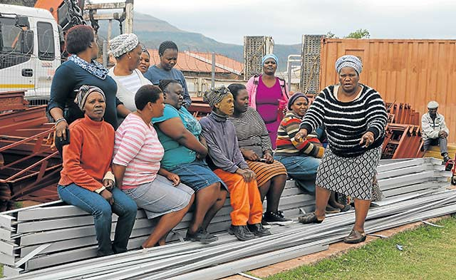 SEARCHING FOR ANSWERS: Members of the Lesseyton Women's Forum are crying foul over the slow progress of a Department of Human Settlements Housing Project worth more than R85-million Picture: BHONGO JACOB