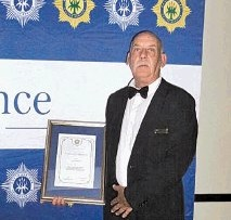 WELL DONE: CPF chairman Andries Schlebusch proudly displays his award received at the provincial police awards